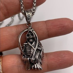 stainless steel chain and santa muerte